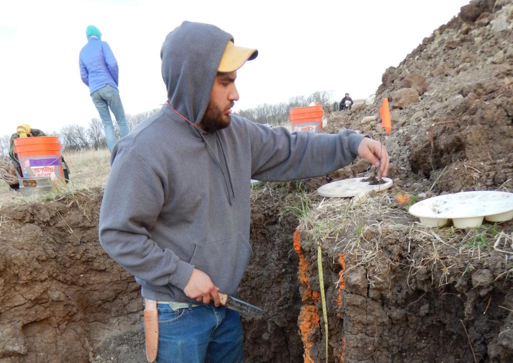 student measuring soils
