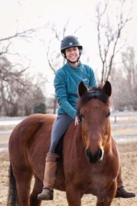 Cayla Stone with her horse.