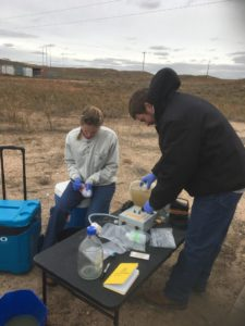 Student and professor filter fluids from a natural gas well