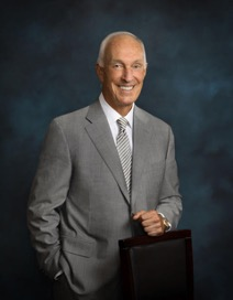 A man in a business suit holding a briefcase