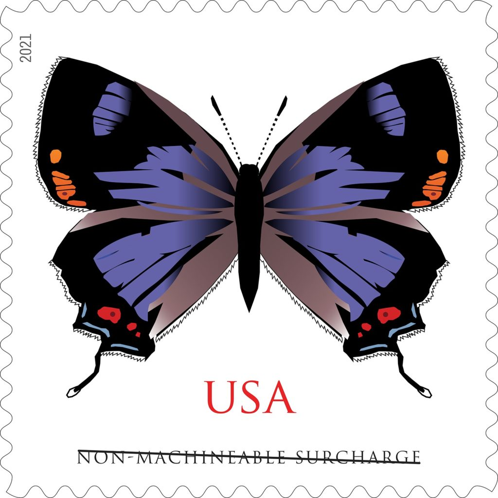 Image of a stamp with a vibrant purple, black and orange butterfly