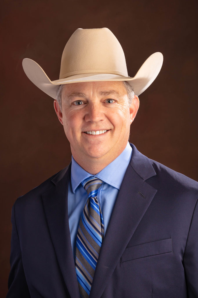 Man in blue suit with cowboy hat